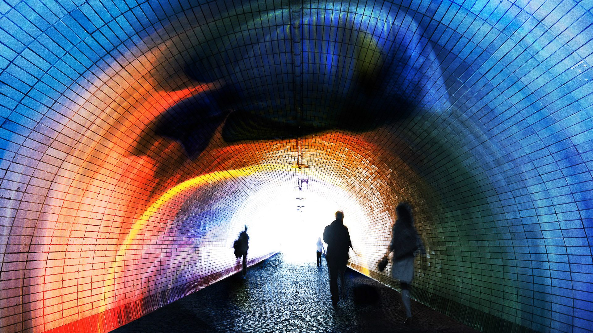 People in bricked tunnel - Prague