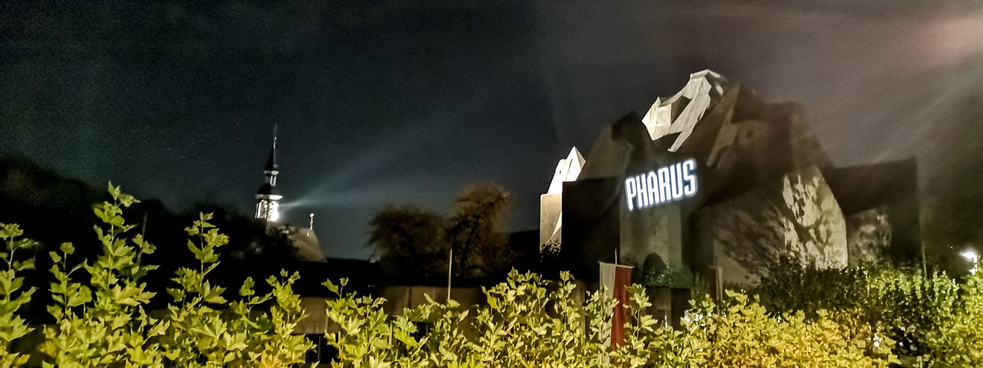 PHARUS lettering projected onto the Mariendom Neviges at night